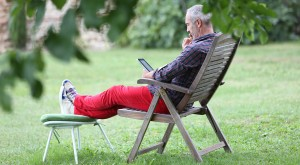 bigstock-Man-relaxing-in-long-chair-EDIT