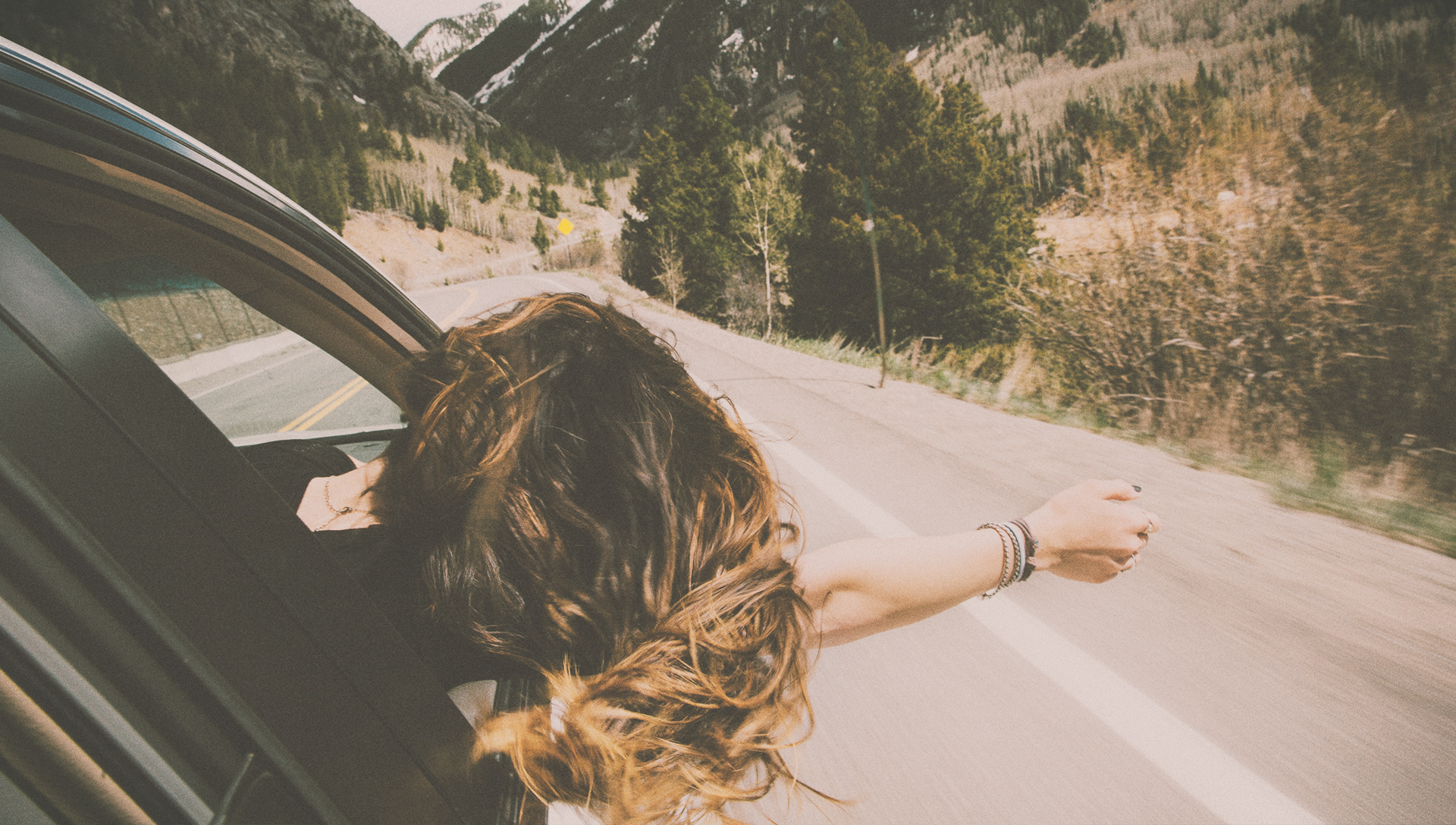 main image for HABAKKUK article on rejoicing, girl leaning out car window on highway